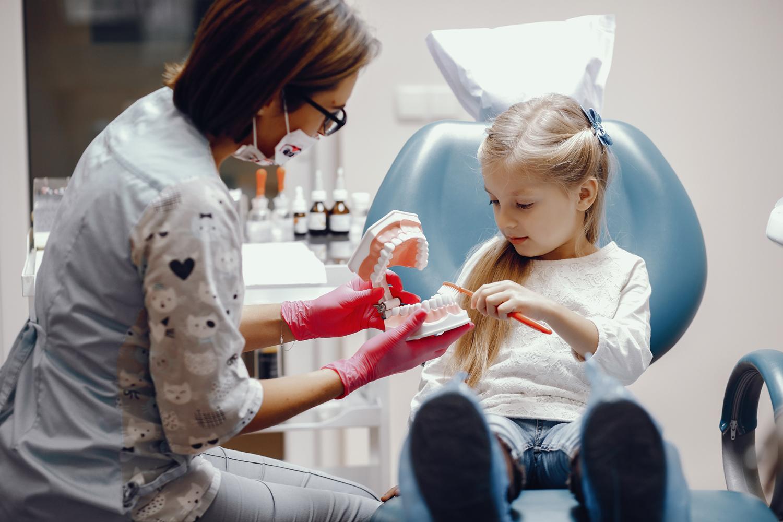 cute-little-girl-sitting-dentist-s-office